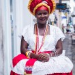 SALVADOR, BRAZIL - JUNE 31: Woman dressed in the traditional clothes of Bahia encourages tourists to enter souvenir shops in Salvador, Brazil on June 31, 2012. Women from Bahia are called Baianas — Stock Photo #44350193