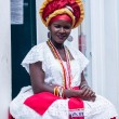 SALVADOR, BRAZIL - JUNE 31: Woman dressed in the traditional clothes of Bahia encourages tourists to enter souvenir shops in Salvador, Brazil on June 31, 2012. Women from Bahia are called Baianas — Stock Photo #44350215