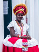 SALVADOR, BRAZIL - JUNE 31: Woman dressed in the traditional clothes of Bahia encourages tourists to enter souvenir shops in Salvador, Brazil on June 31, 2012. Women from Bahia are called Baianas — Photo