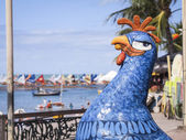 PORTO DE GALINHAS, BRAZIL - JULY 21: Colorful sculptures of chickens, the symbol of Porto de Galihnas, famous Brazilian resort town known for its beaches and natural pools on July 21, 2012. — Stock Photo
