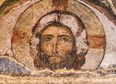 VARDZIA, GEORGIA - MARCH 23, 2014: Jesus Christ, tympanum over the door of the 12th century Church of Dormition in Vardzia cave city-monastery in Georgia, Caucasus — Stock Photo