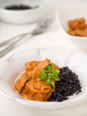 Paneer tikka masala with black rice — Stock Photo