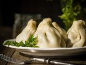 Georgian meat dumplings called khinkali — Stock Photo