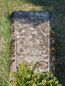 Grave in church graveyard — Stock Photo