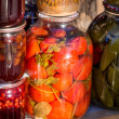 Jars with traditional home-made tomatoes and other preserves — Stock Photo #46293511