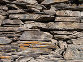 Wall built from shale stones, typical built material in Tusheti, Georgia. — Stock Photo
