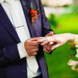 At the wedding groom wears the ring bride — Stock Photo #44729249