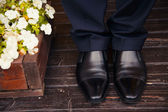 Men legs in shoes on the floor — Stock Photo