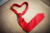 Red necktie shape of heart — Stock Photo