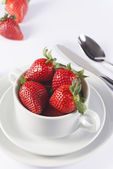Festive table set with strawberry in bowl on white background — Stockfoto