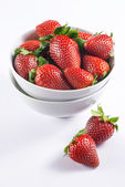 Fresh strawberry in double bowl on white background side view — Stockfoto