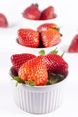 Strawberry ramekin lineup on white background — Stock Photo