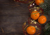 Christmas postcard mandarins and fur tree — Stock Photo