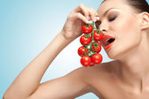 Woman with tomatoes. — Stock Photo