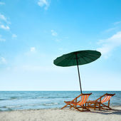Beach chairs and umbrella — Foto Stock