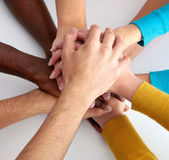 Team of friends showing unity with their hands together — Stock Photo