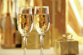 Champagne with gold gifts — Photo