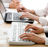 Hands over keyboards — Stock Photo