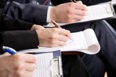 Business people making notes — Stock Photo