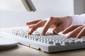Hands touching keyboard — Stock Photo