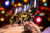 People hands with champagne — Stock Photo