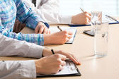 Business people writing notes — Stock Photo