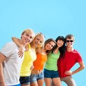 Teenagers on blue background — Stock Photo