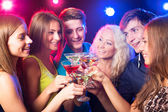 Friends clinking by glasses — Stock Photo