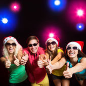 Happy people in Santa hats — Stock Photo