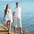 Couple walking on beach — Stock Photo #44738361