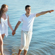 Couple walking on beach — Stock Photo #44738367
