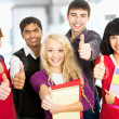 Students giving the thumbs-up sign — Stock Photo #44739989