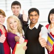 Students giving the thumbs-up sign — Stock Photo #44739993