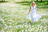 Woman among dandelions — Stock Photo