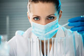 Female scientist working in laboratory — Stock Photo