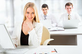 Cute businesswoman in an office — Stock Photo
