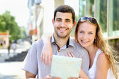 Young couple walking around the city — Stock Photo