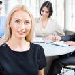 Business woman with colleagues — Stock Photo