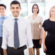 Business team standing in a row — Stock Photo #44746951