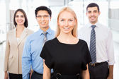 Business people with businesswoman leader — Stock Photo