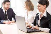 Three business people work at office — Stock Photo
