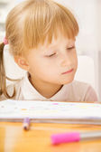 Girl looking at copybook — Stock Photo
