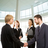 Businessmen shake their hands — Stock Photo
