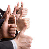 Hands showing thumbs up signs — Stock Photo