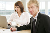 Working of two business people — Foto Stock