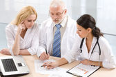 Professor and two physicians — Stock Photo