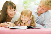 Happy family reading — Stock Photo