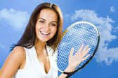 Pretty woman with a tennis racket — Stock Photo