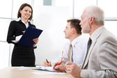 Businesswoman making presentation — Foto Stock