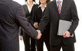 Businessmen shake hands — Stock Photo